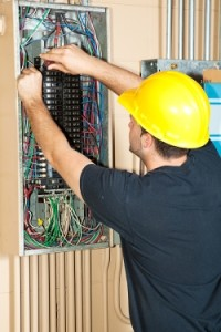 picture of an electrical contractor repairing electric service panel